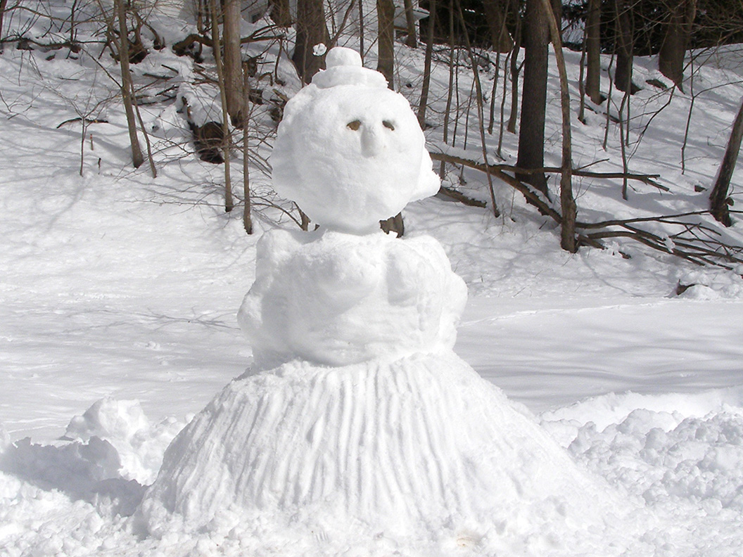 Female snowman. Snowlady.